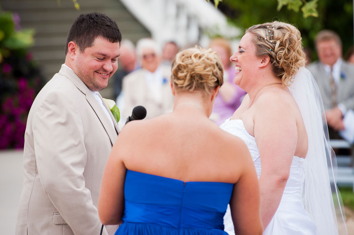 Bride & groom share a laugh during their wedding at Blue Harbor Resort.