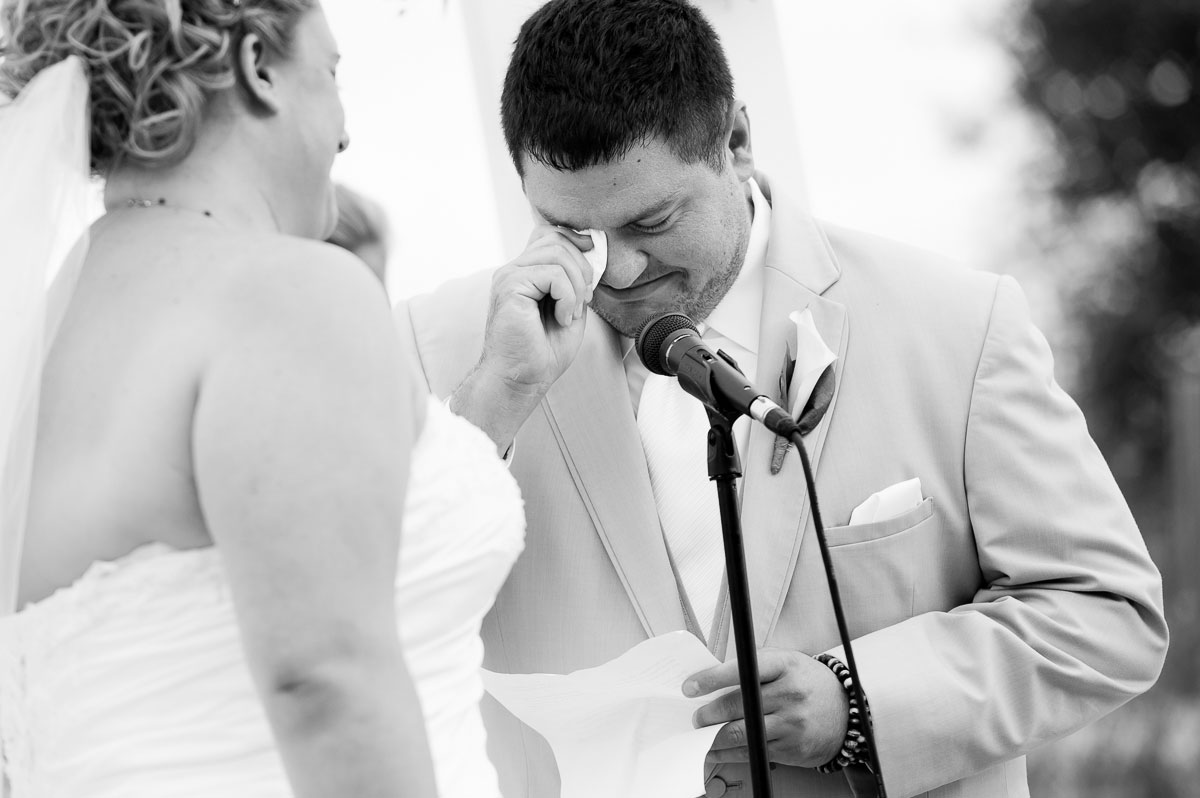 The groom cries as he reads his vows at a wedding ceremony at Blue Harbor Resort.