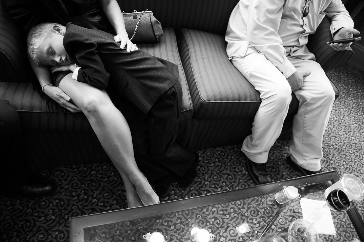 One of the ring bearers takes a nap during a Blue Harbor Resort wedding.