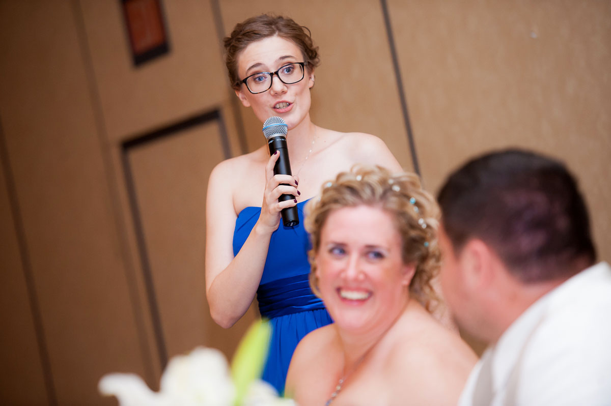 Maid-of-honor gives her toast during her sister's wedding at Blue Harbor Resort.