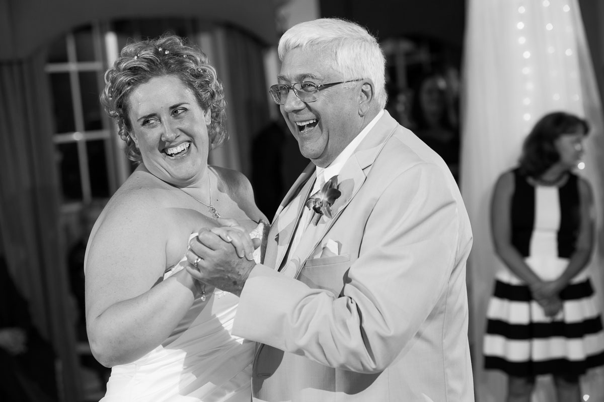 Father & daughter dance during a wedding reception at Blue Harbor Resort.