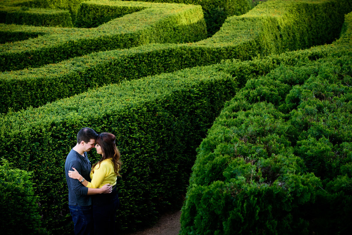 Couple embraces in the maze gardenduring their engagement session at the Morton Arboretum in Lisle, IL.