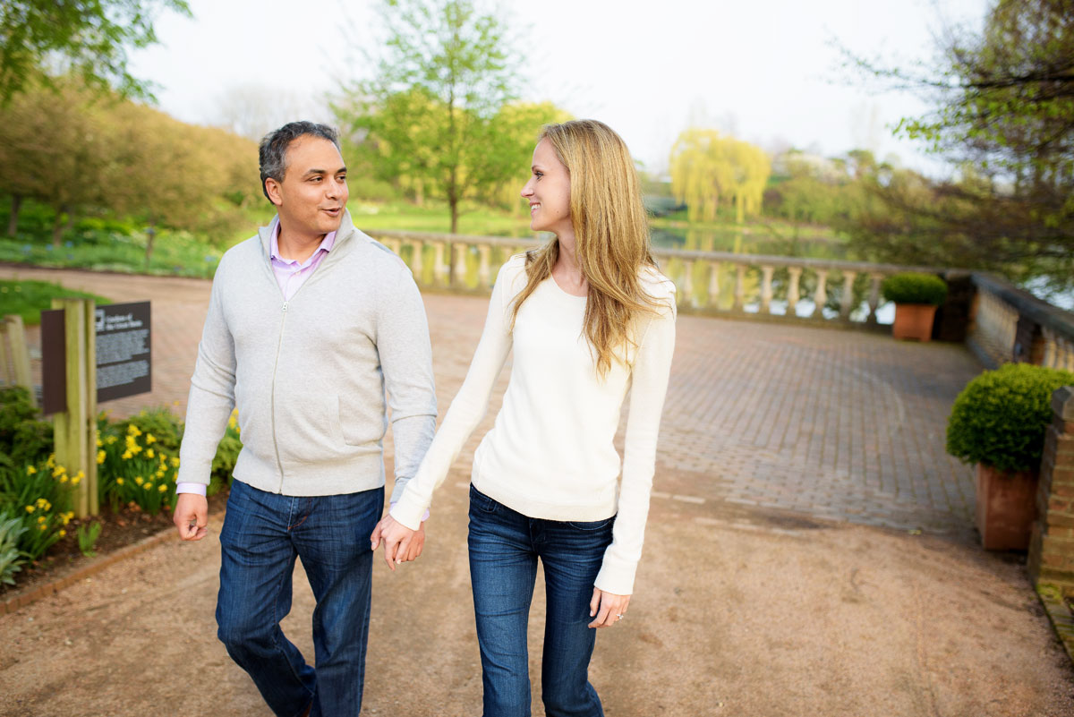 Couple take a stroll through the Chicago Botanic Gardens during their engagement session.