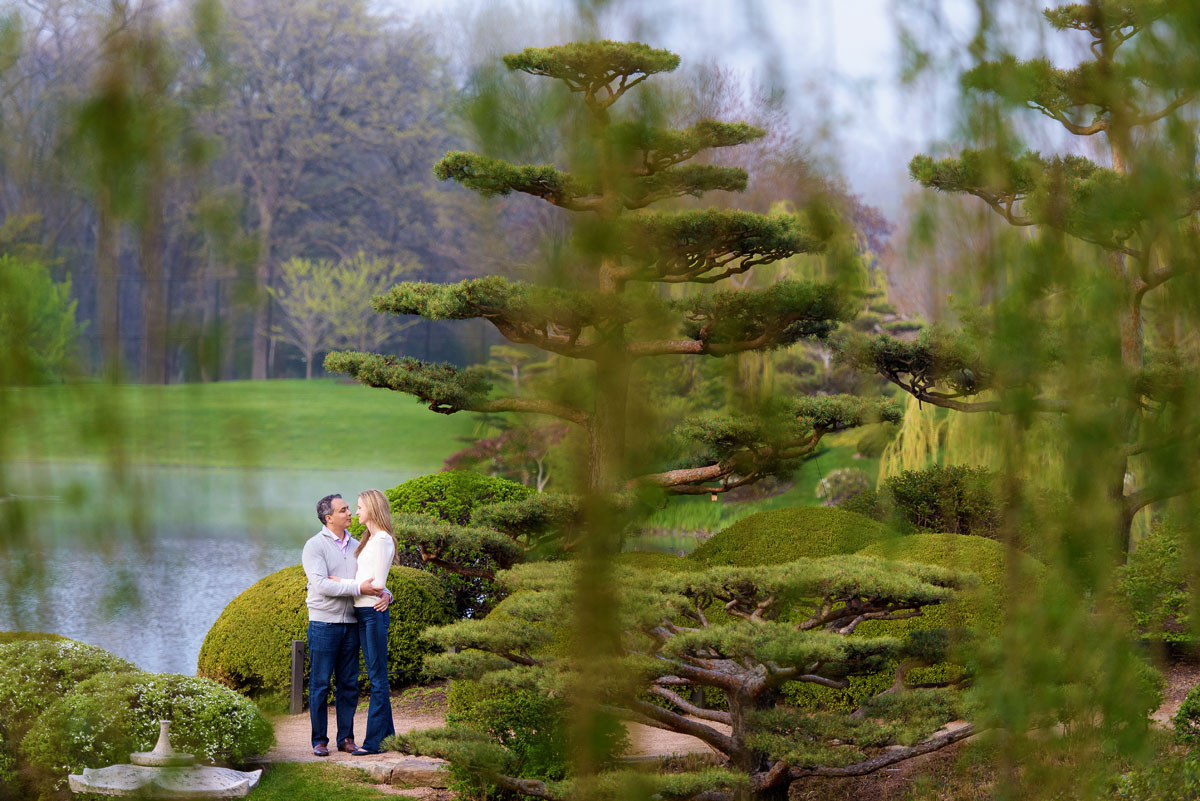 Couple stands in the Japanese gardens at the Chicago Botanic Gardens for their engagement photos.