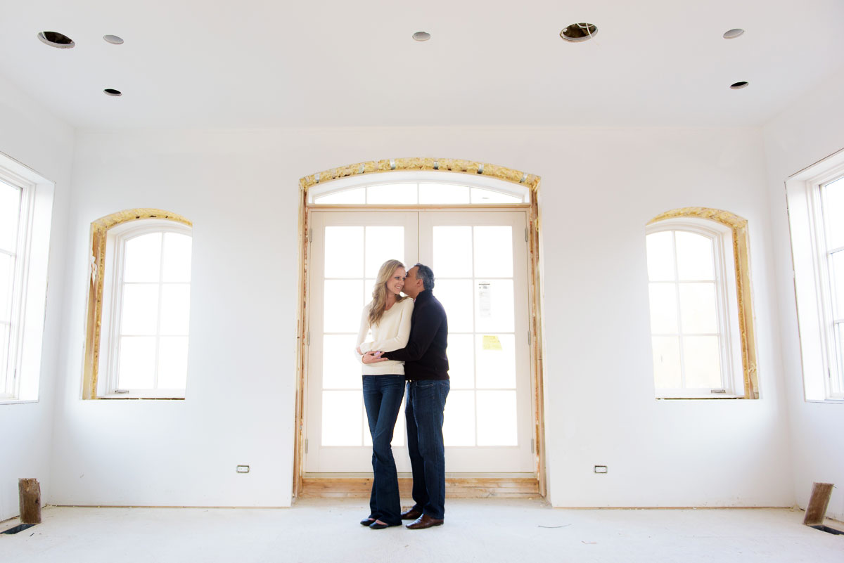 Chicago engagement photo of the couple at their newly constructed Wicker Park home.