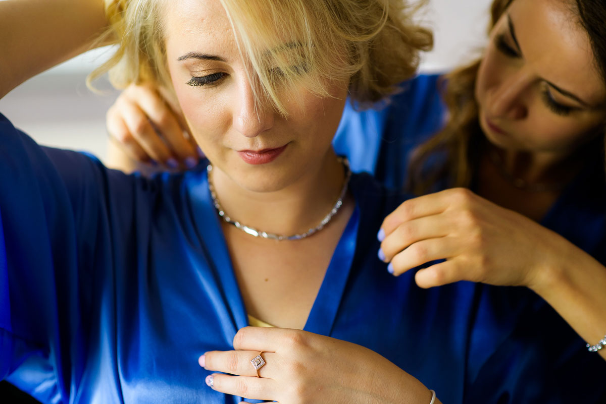Bridesmaids put on their jewelry before a wedding at the Trump Tower Chicago.
