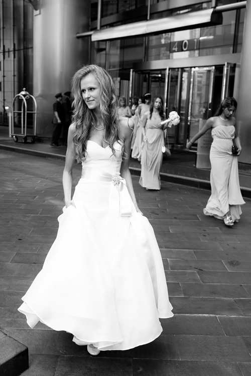 Bride and wedding party leave the Trump Tower Chicago for the Harold Washington Library on her wedding day.