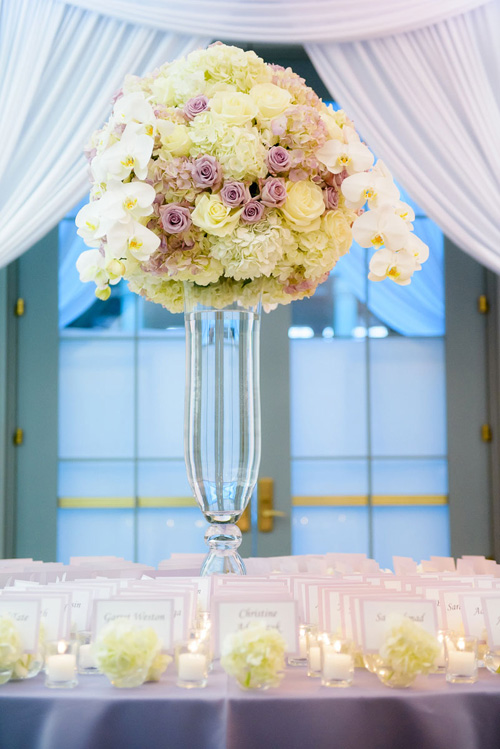 Flowers and place cards at a Winter Garden wedding at the Harold Washington Library Chicago.