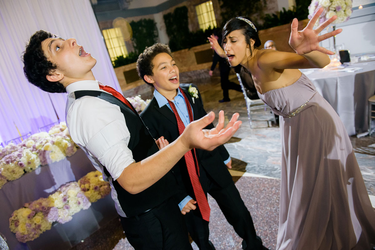 Kids have fun dancing during a  wedding reception at the   Winter Garden in the Harold Washington Library Chicago.
