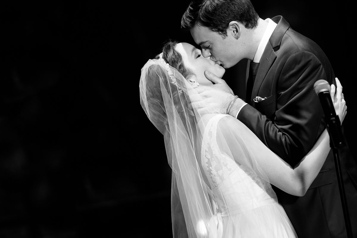 Bride & groom share their first kiss during their wedding at the Bridgeport Arts Center.