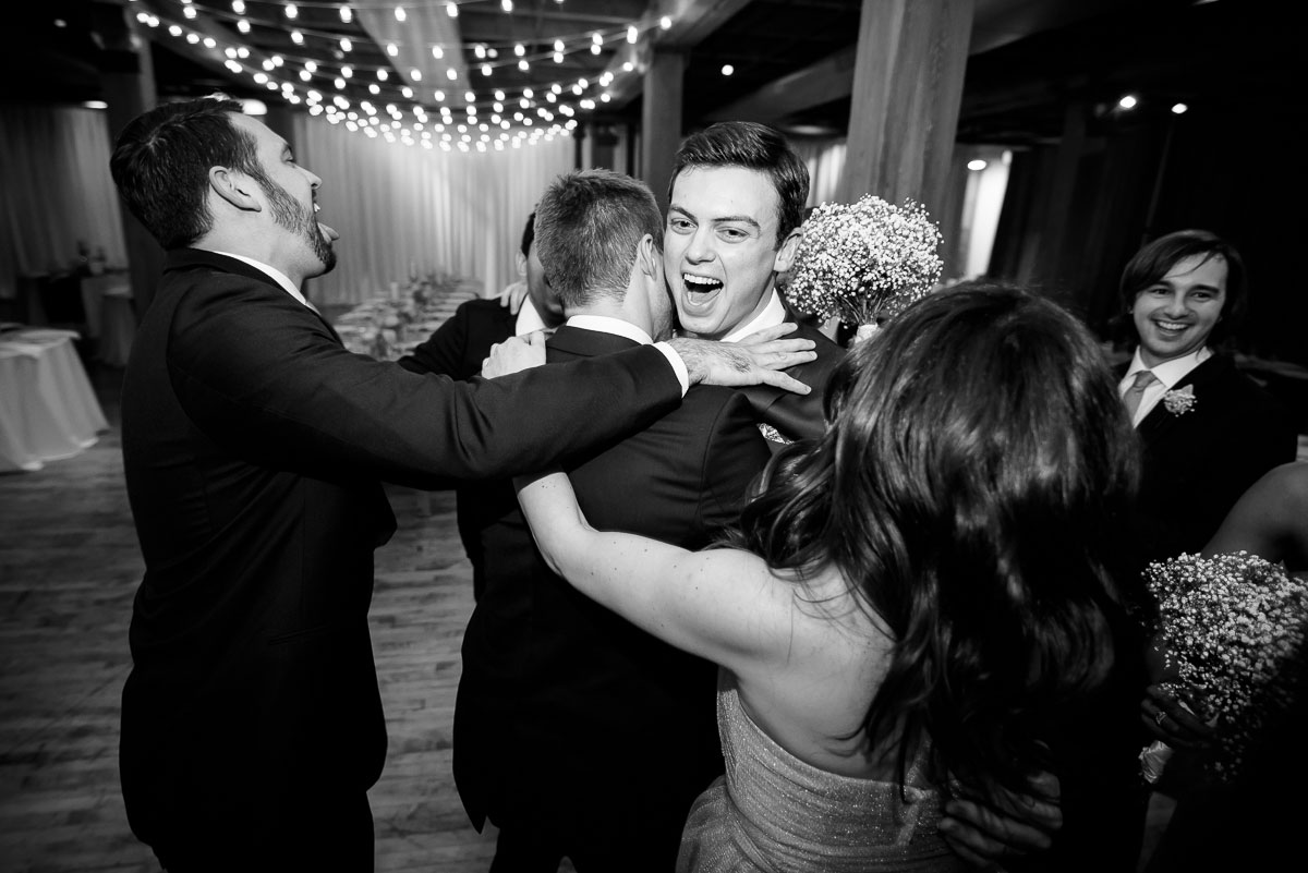 Bridal party celebrates after the wedding ceremony at the Bridgeport Arts Center.