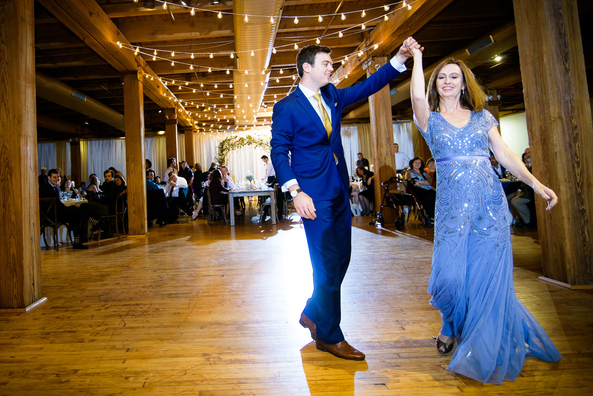 The groom and his mother dance at his Bridgeport Arts Center wedding.