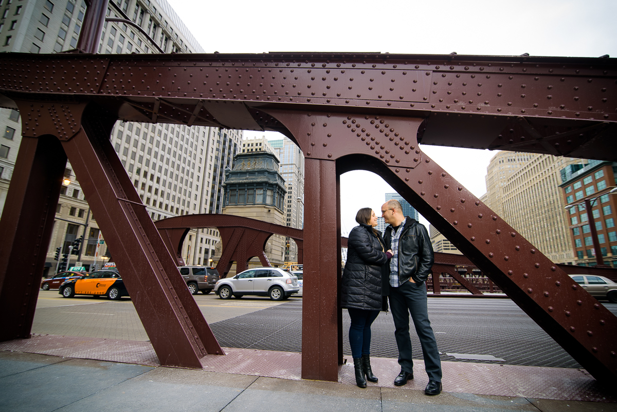Bride & groom stand under the LaSalle Street Bridge during their Chicago engagement session.