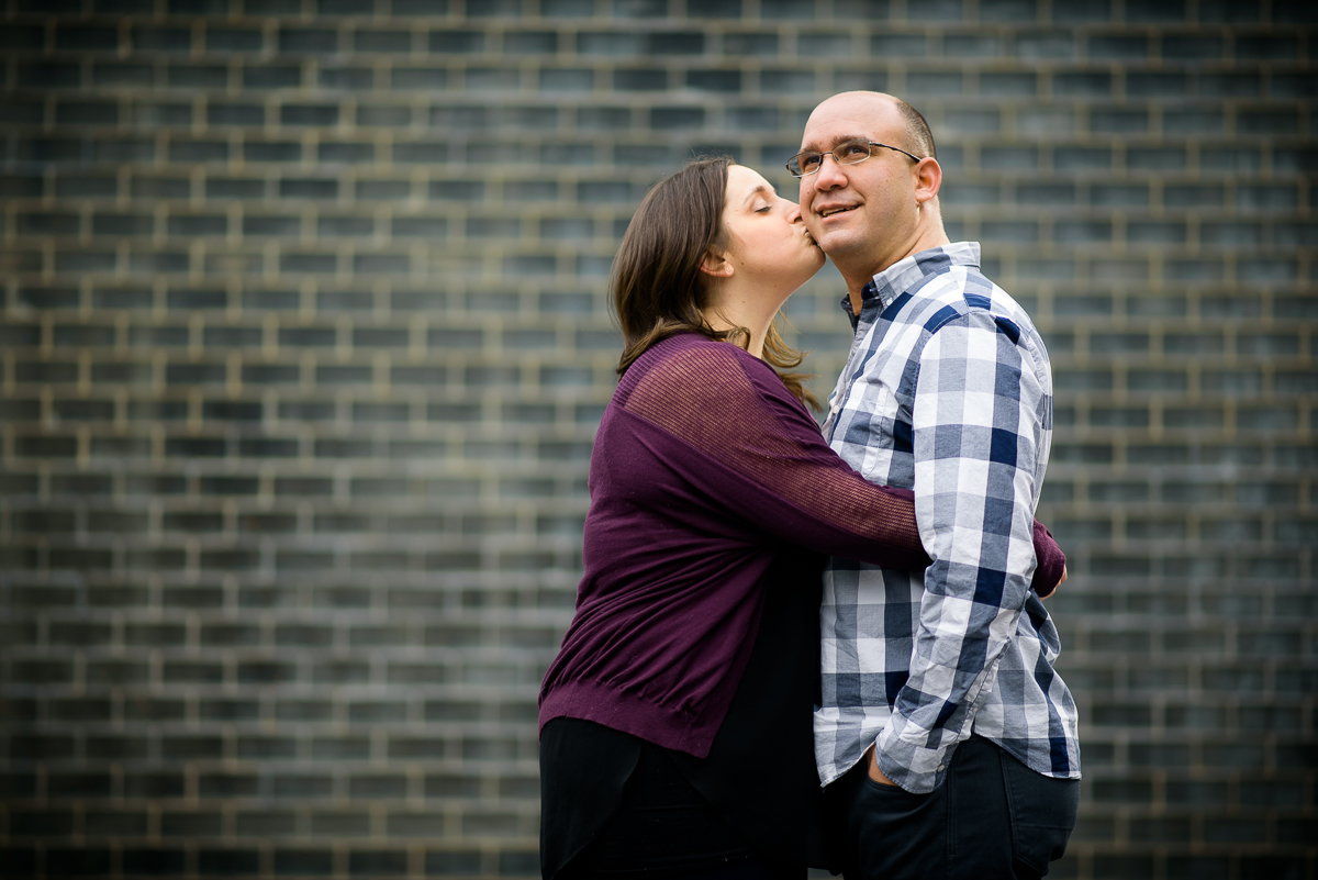 A couple stops to share a moment at Crown Fountain - Millennium Park during their Chicago engagement session.