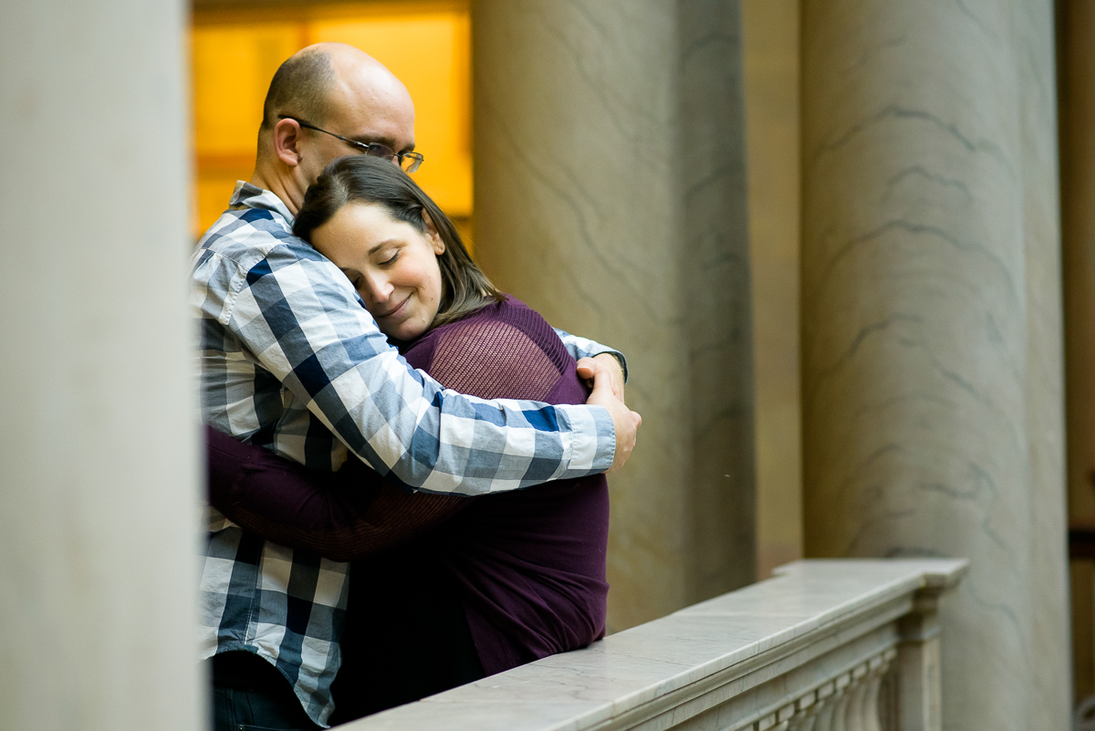 Couple embraces during their engagement session at the Art Institute of Chicago.