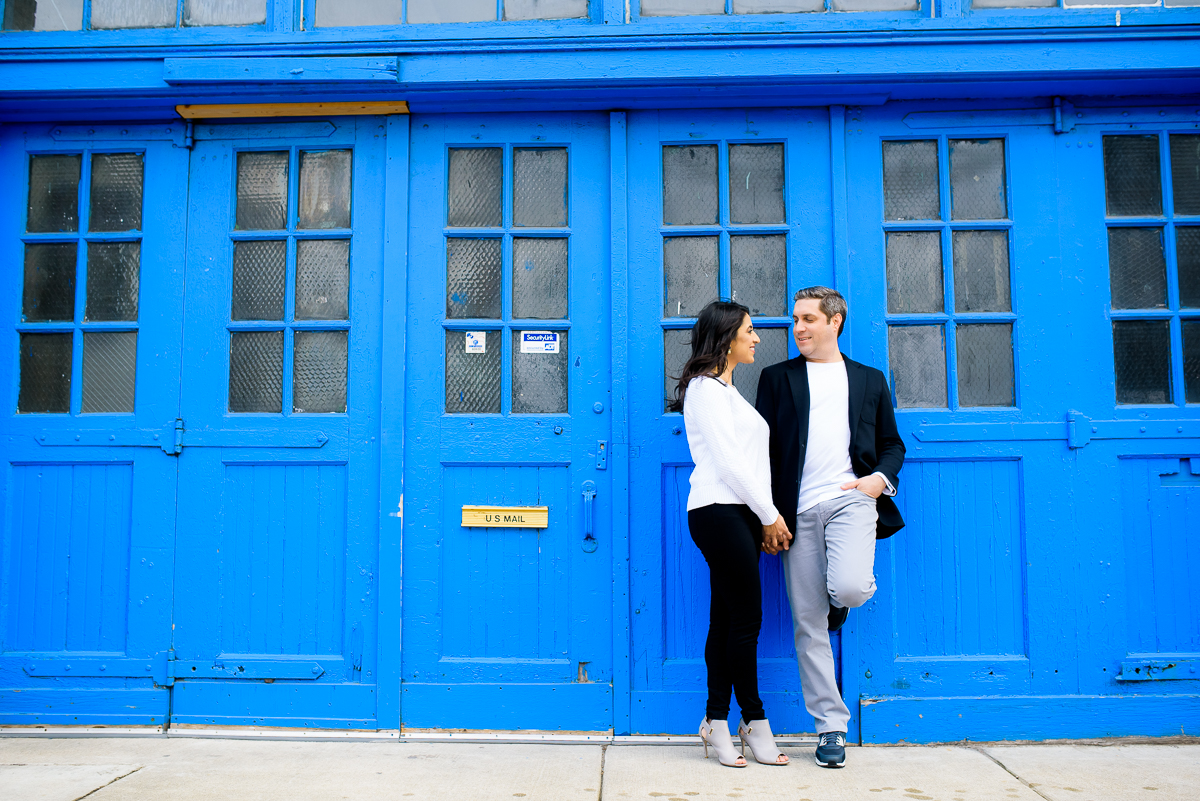 The couple hangs outside the Mars Gallery in Fulton Market during their Chicago engagement session.