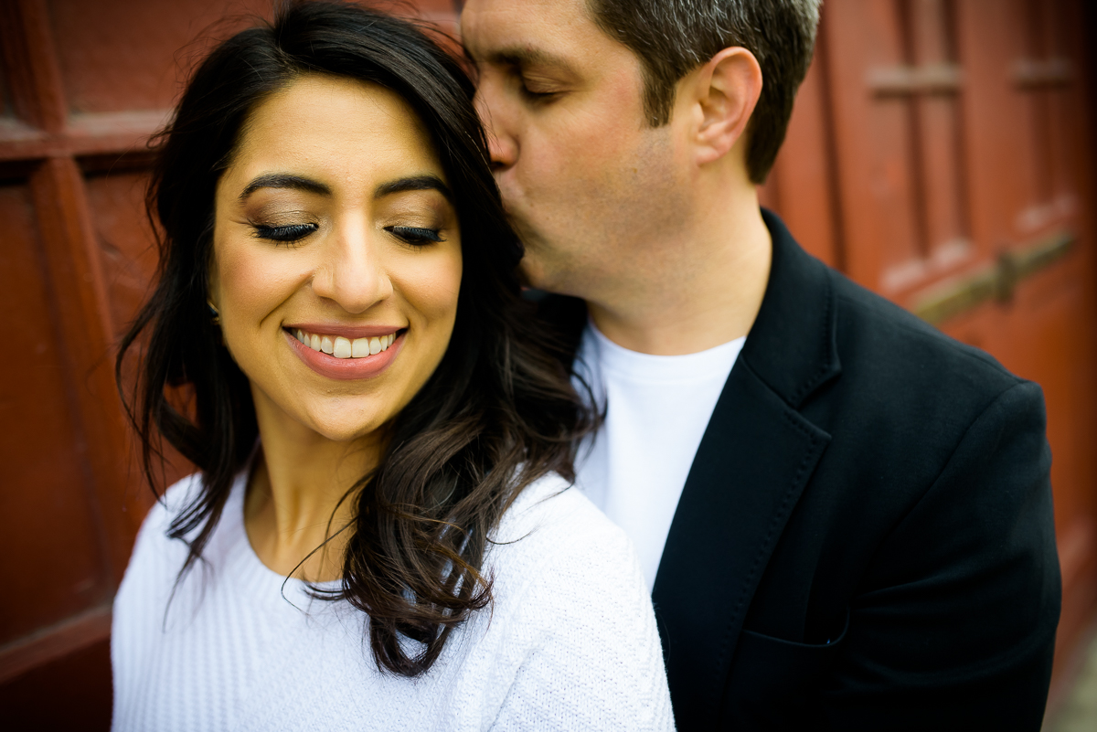 Bride & groom share a moment together near the Mars Gallery in Fulton Market during their engagement session.