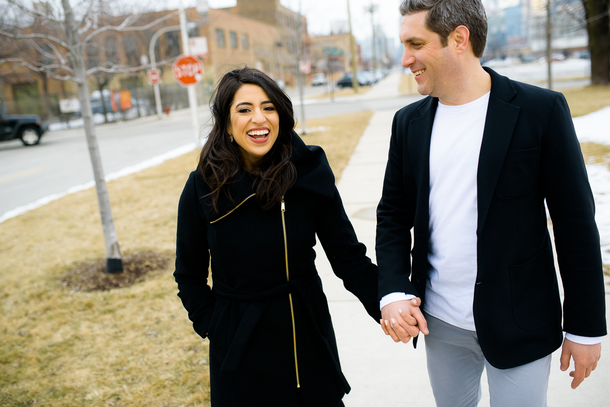 The couple shares a laugh during their Chicago engagement session near Fulton Market.