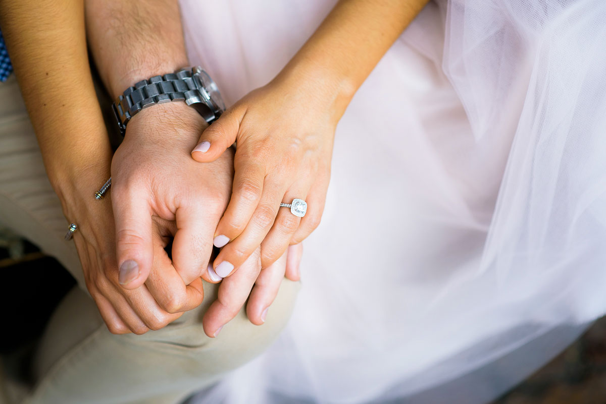 Couple holds hands during their Chicago engagement session at Volo in Roscoe Village.