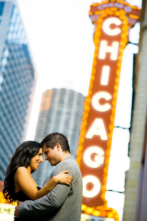 Couple stops by the Chicago Theater during their engagement session.