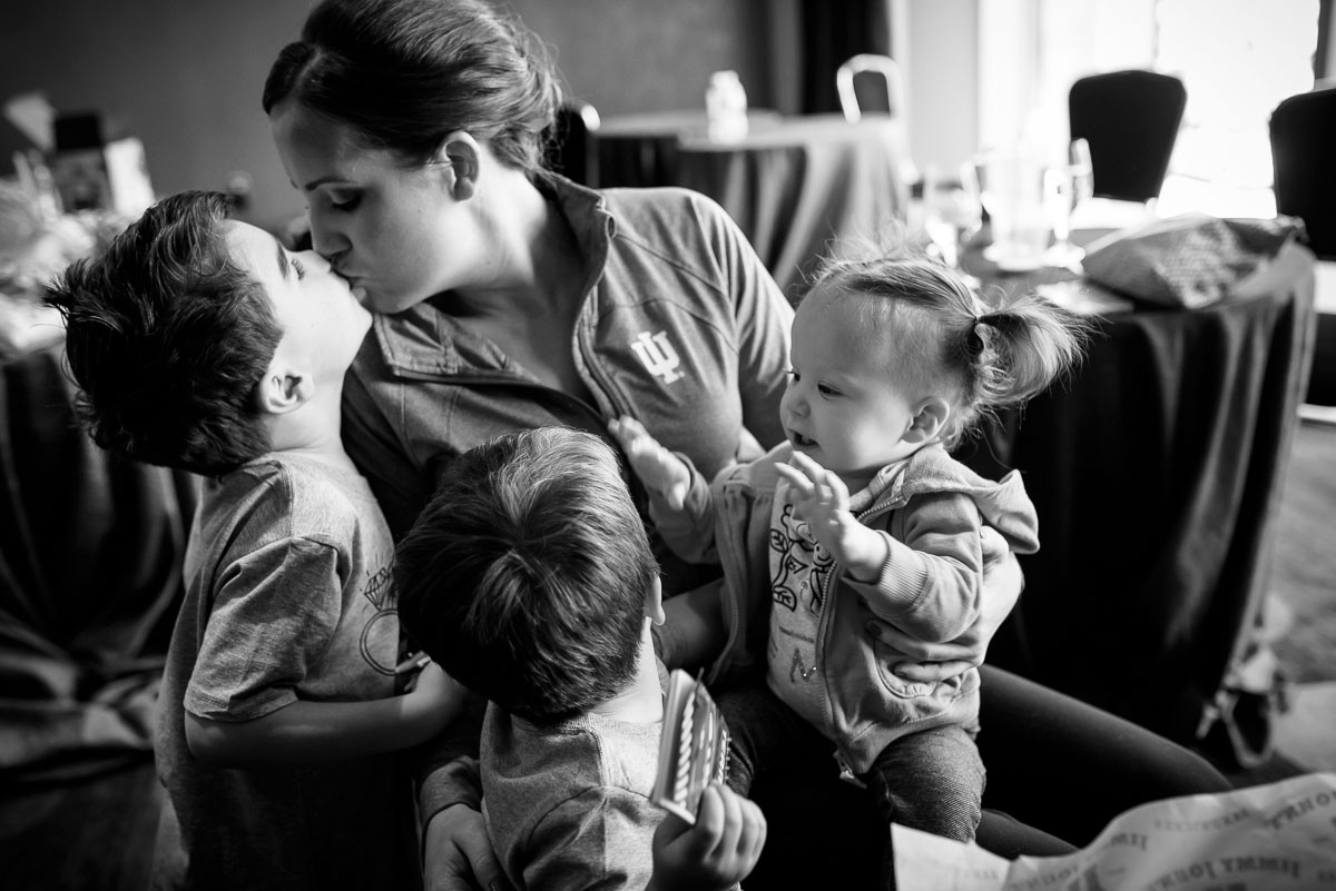 A bridesmaid shares a moment with her children while getting ready at the Sofitel Chicago.