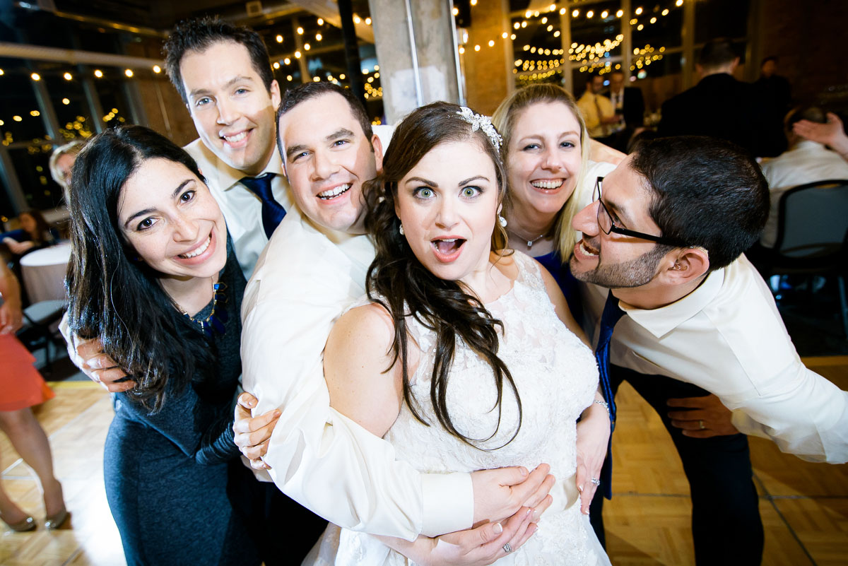 The bridal party goofs off during their Kendall College Chicago wedding.