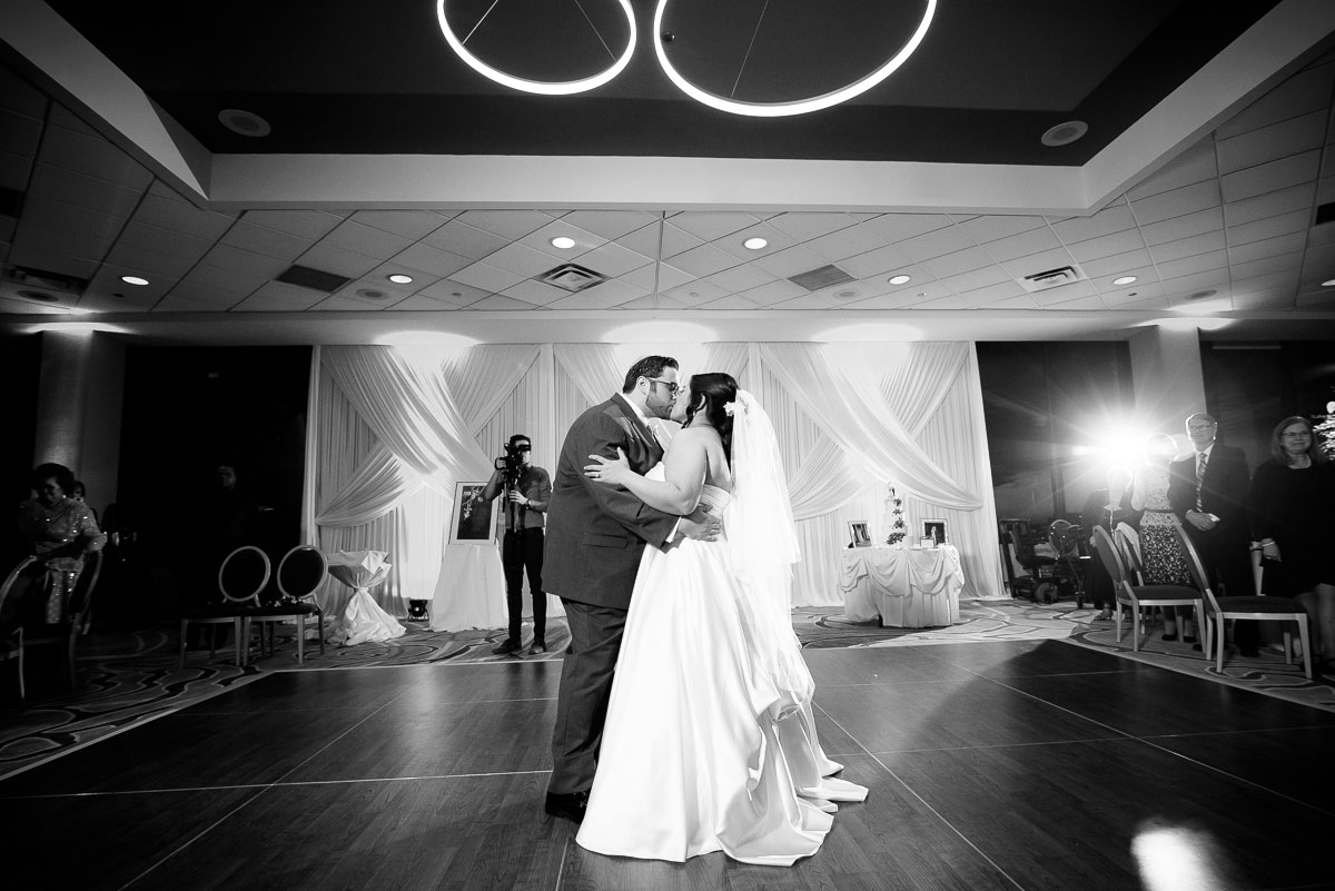 Bride & groom kiss during their first dance on their wedding day at the DoubleTree Skokie.