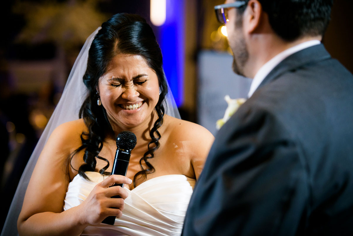 Bride laughs during her toast to her groom at the DoubleTree Skokie.