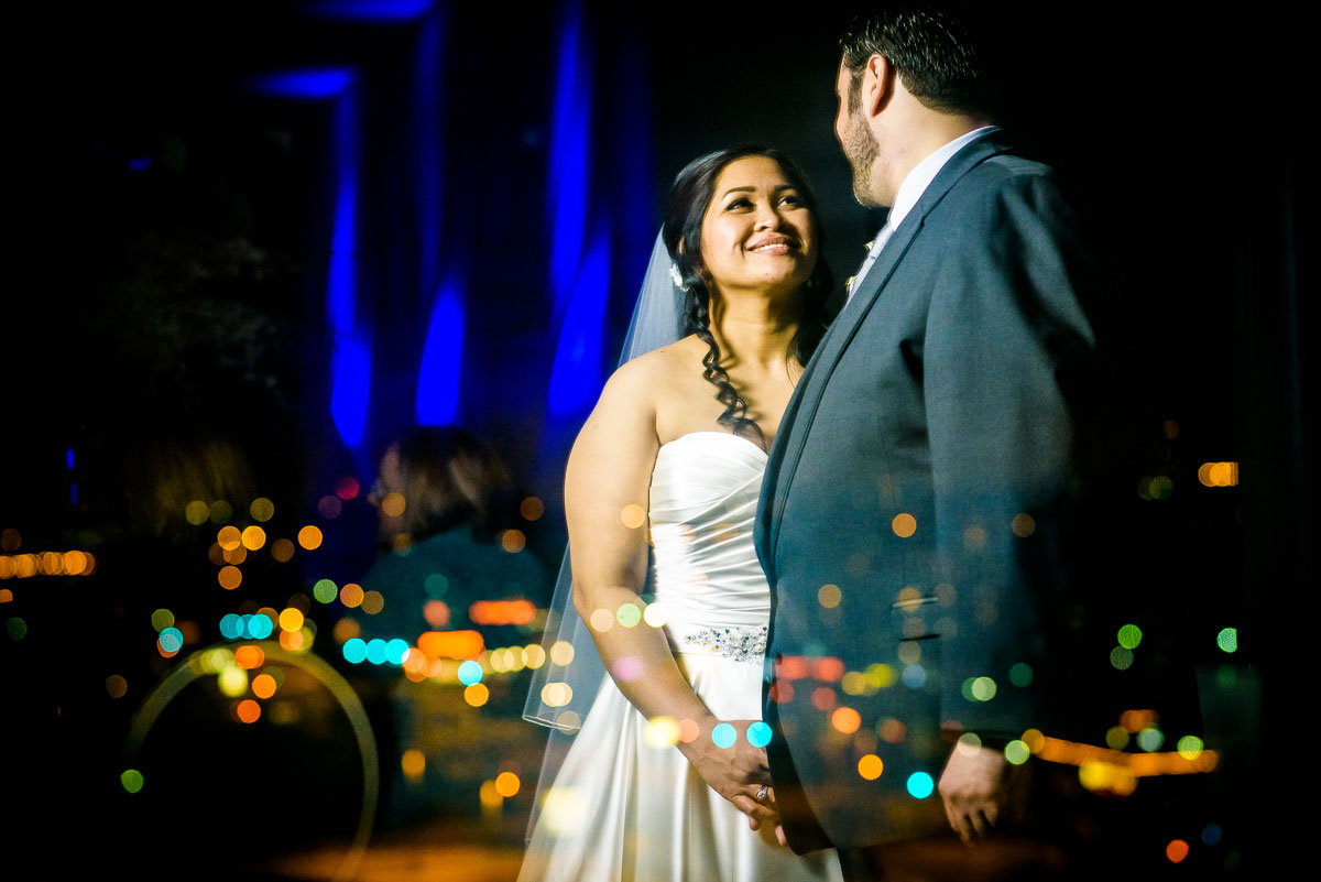 Creative night portrait of the bride & groom at the DoubleTree Skokie at their wedding.