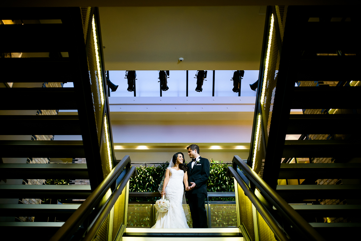 Creative wedding portrait on the grand staircase at the Thompson Chicago in the Gold Coast.