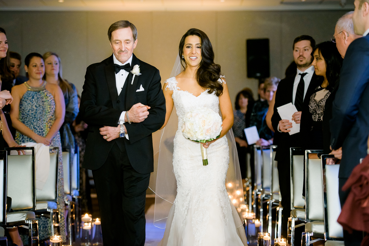 Father walks her daughter down the aisle during her wedding at the Thompson Chicago.