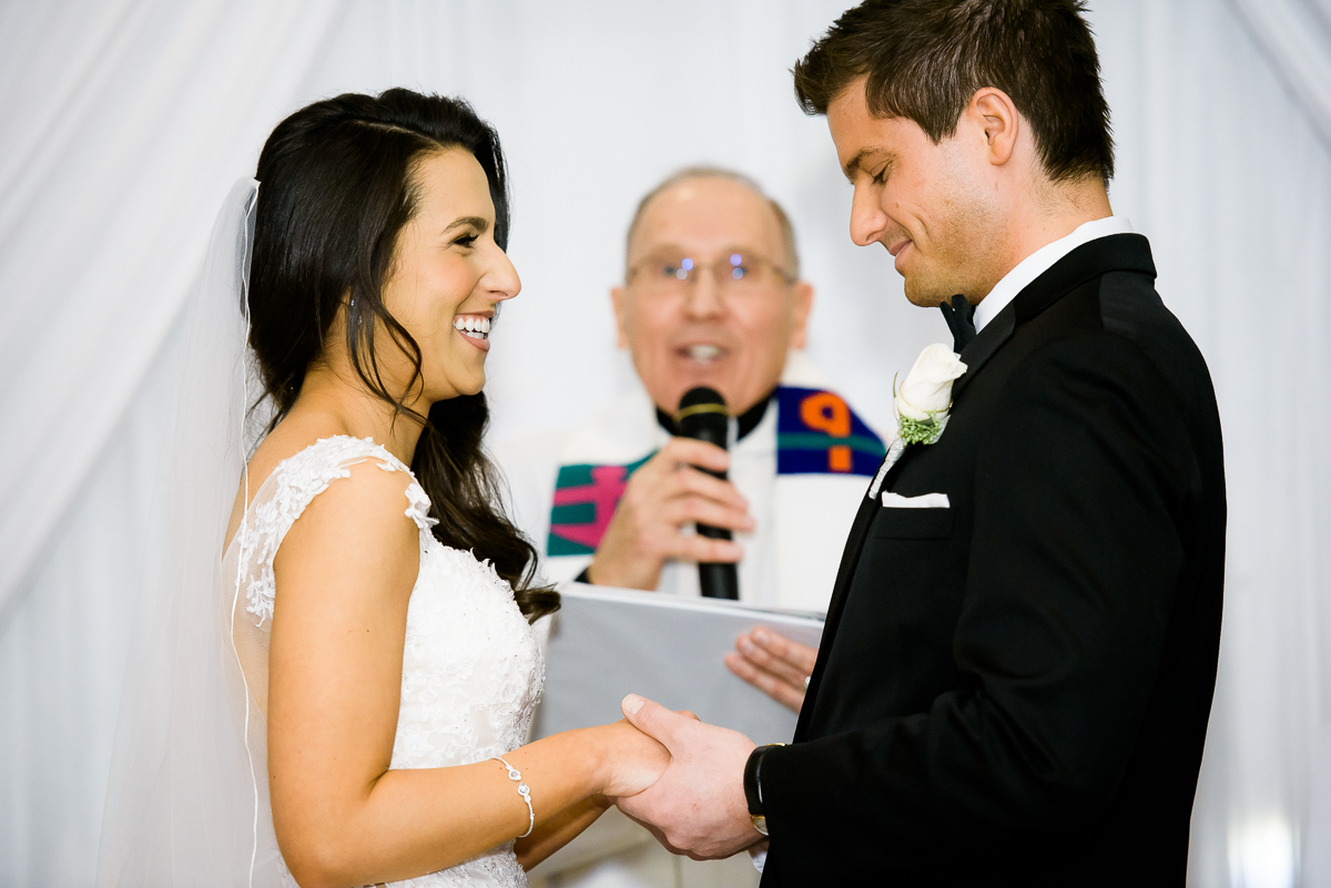 Bride & groom share a moment during their wedding ceremony at the Thompson Chicago.