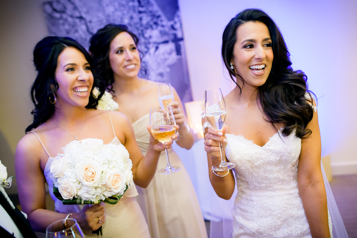 Bride shares a moment with her bridesmaid just after her Thompson Chicago wedding ceremony.