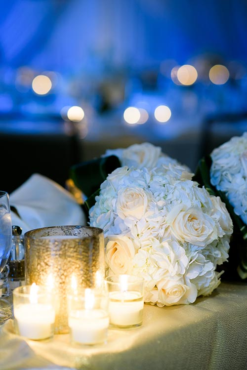 Candles and flowers during a Thompson Chicago wedding.