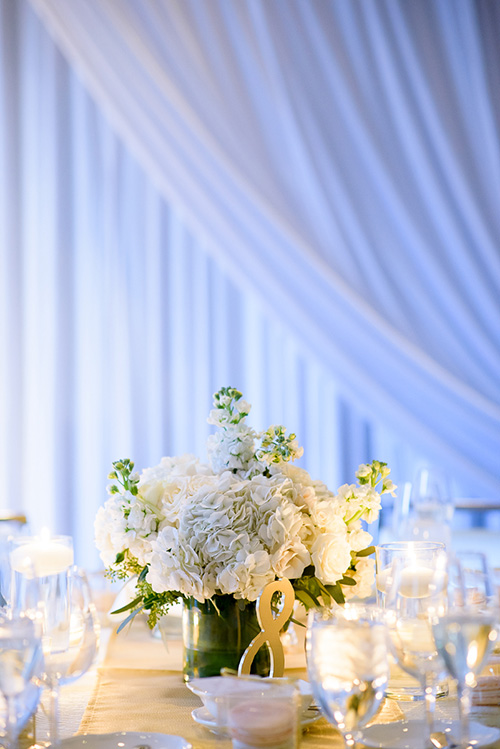 Center pieces by Mt. Prospect Flowers at a Thompson Chicago wedding.