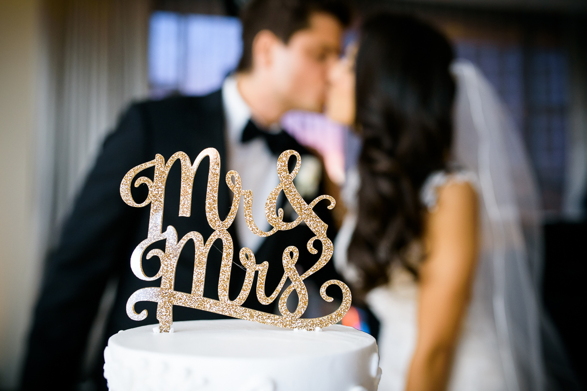 The couple kisses after their cake cutting at a Thompson Chicago wedding.