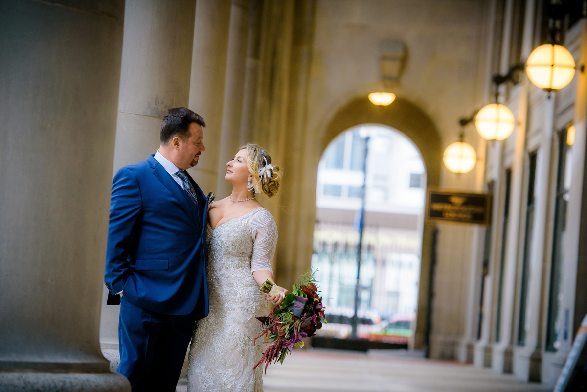 Wedding photo of the bride & groom outside Union Station Chicago.