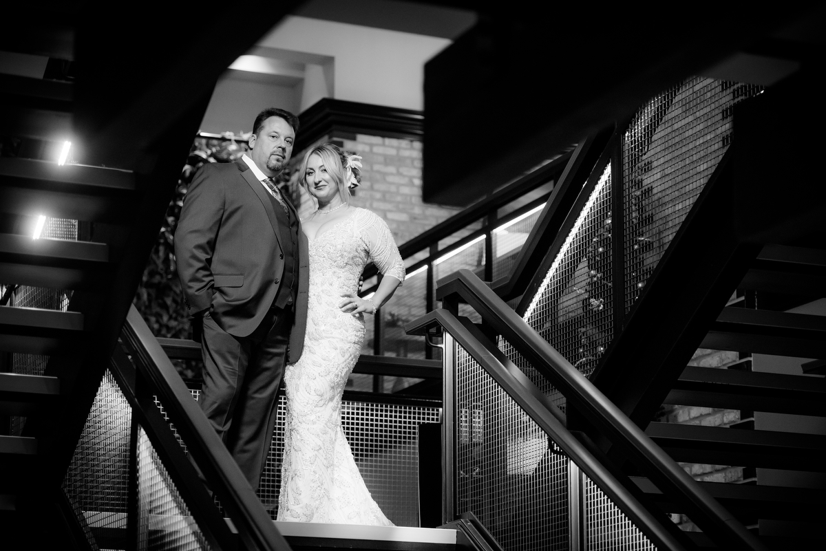 Wedding photo of the bride & groom on the grand stair of the Thompson Chicago.
