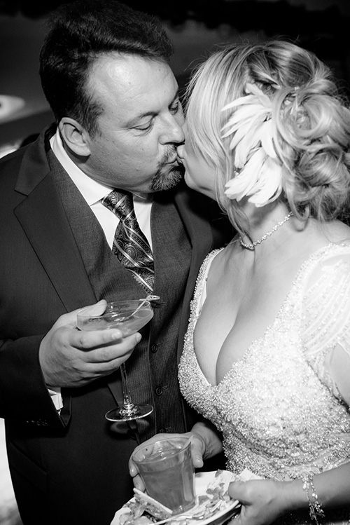 Couple shares a kiss during their New Year's Eve wedding at the Thompson Chicago.
