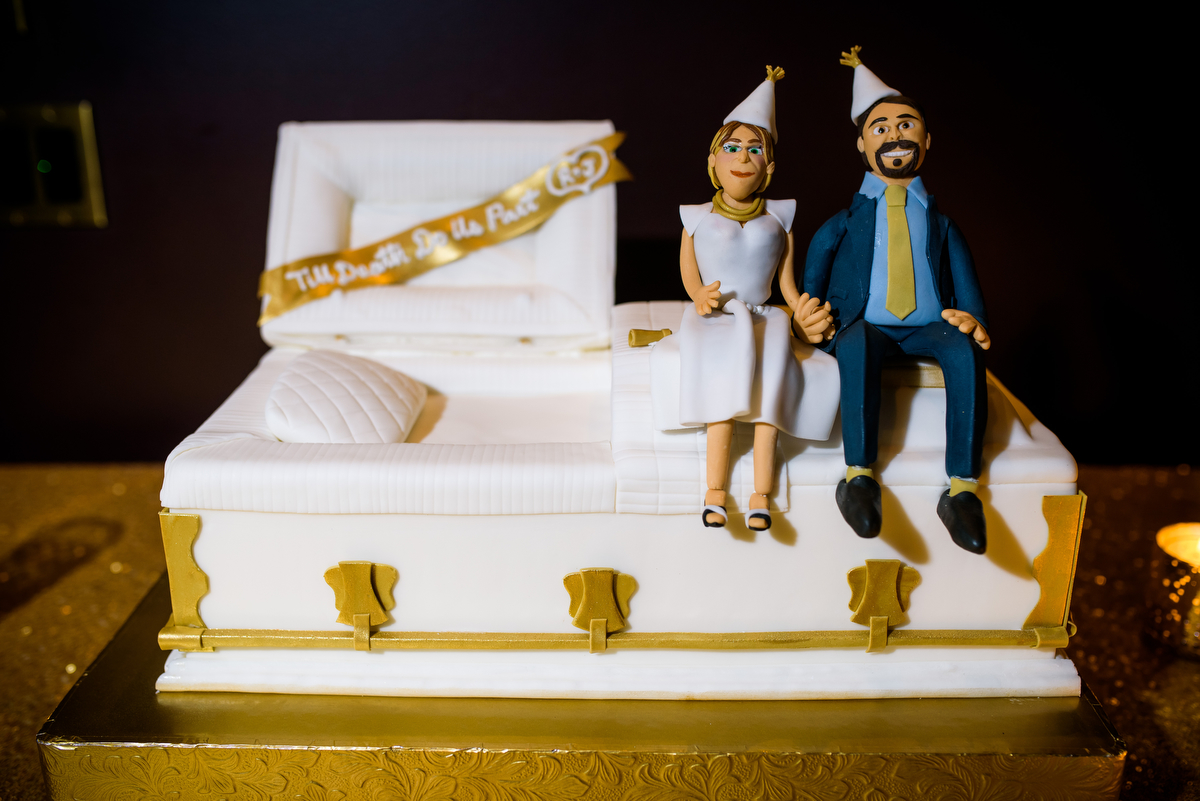 An amazing wedding cake made to look like a casket (the groom owns funeral homes) at a New Year's Eve wedding at the Thompson Chicago. Cake by Bittersweet.