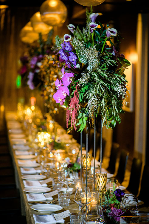 Beautiful centerpieces by Stems Chicago at a New Year's Eve wedding at the Thompson Chicago.