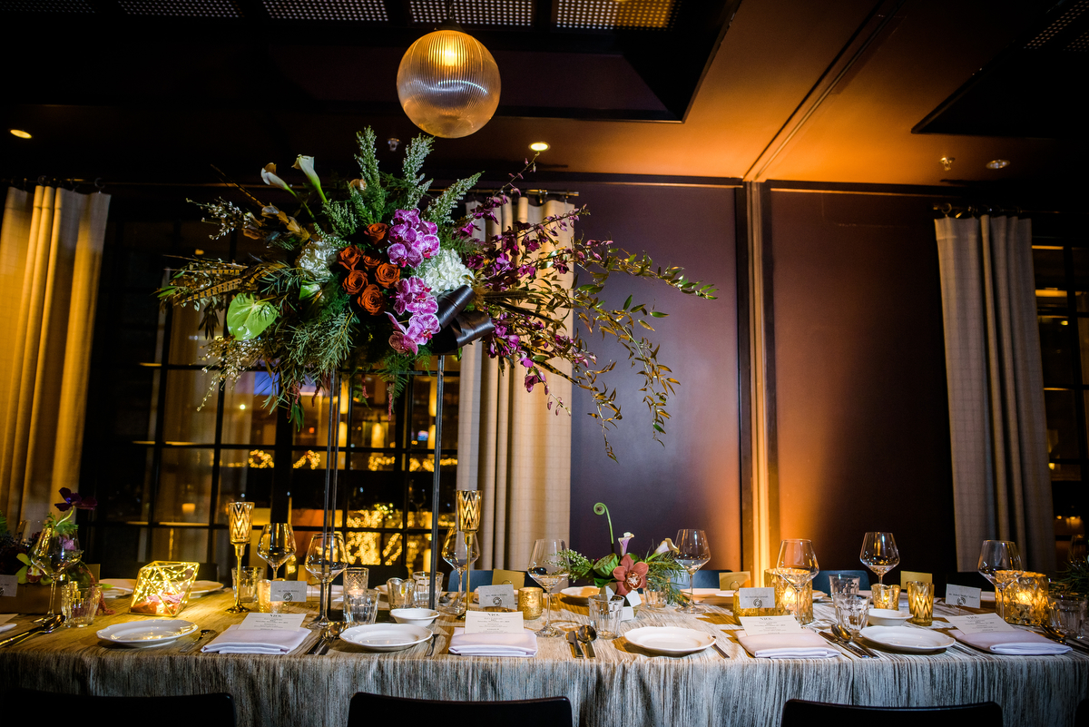 Centerpieces done by Stems Chicago at a New Year's Eve wedding at the Thompson Chicago.