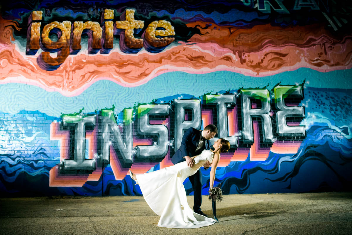 Creative wedding night portrait outside Moonlight Studios Chicago.