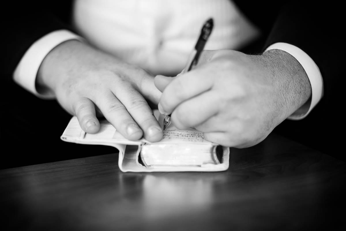 Groom writes a note to his bride before their wedding at Moonlight Studios Chicago.