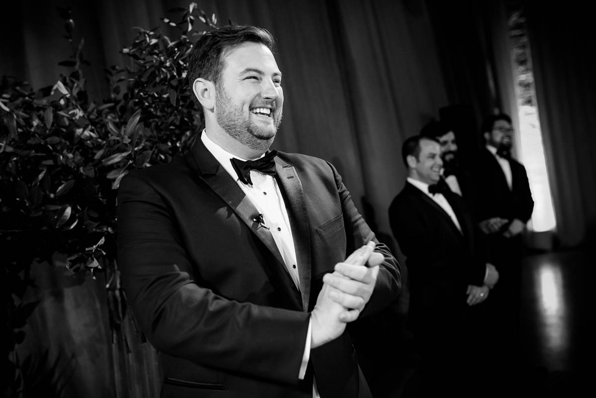 Groom reacts to his bride walking down the aisle at Moonlight Studios Chicago.
