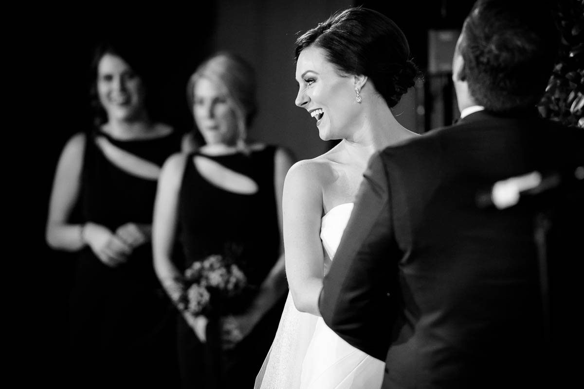 Bride laughs during the wedding ceremony at Moonlight Studios Chicago.