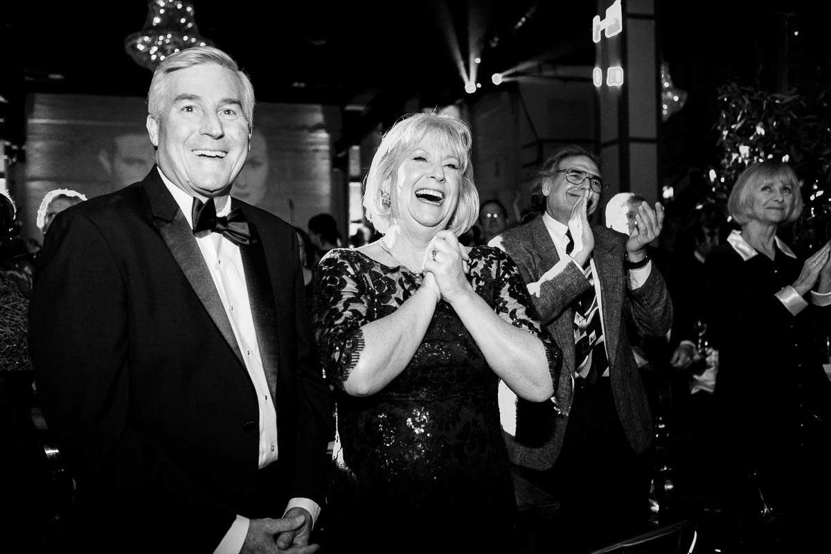 Parents of the bride react as the couple is introduced at their Moonlight Studios Chicago wedding.
