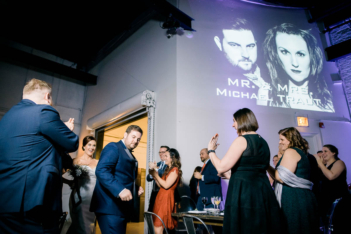Couple make their entrance during their Moonlight Studios Chicago wedding.