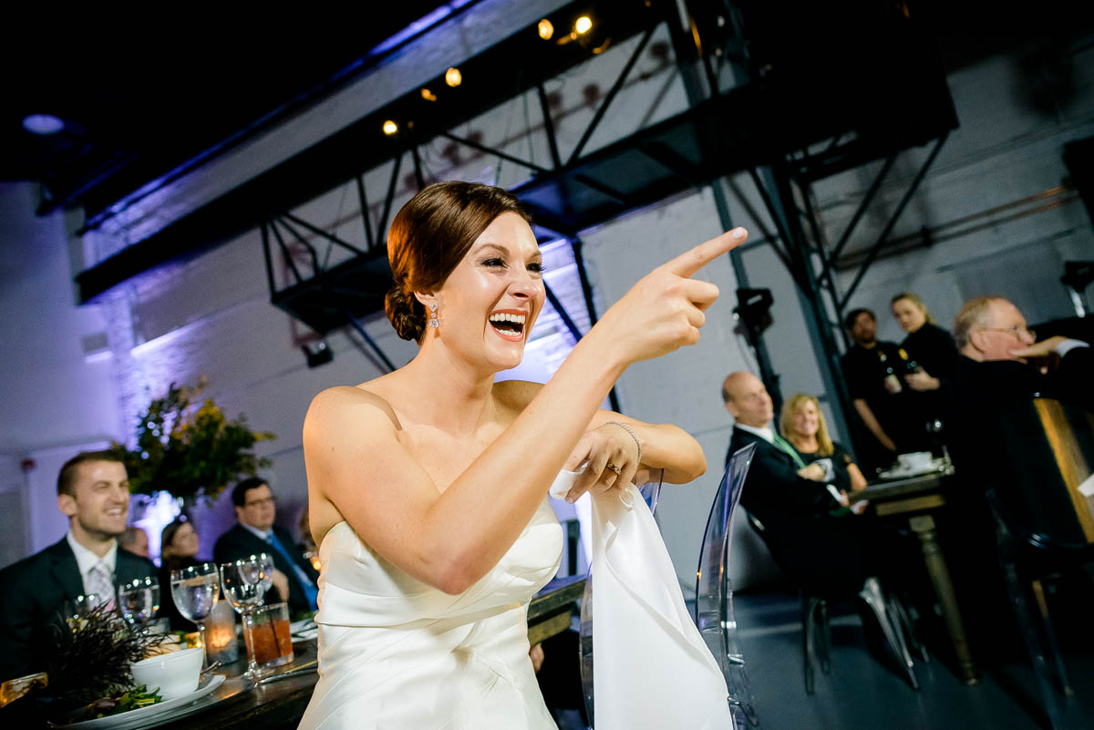 Bride reacts to maid of honor speech during her Moonlight Studios Chicago wedding.