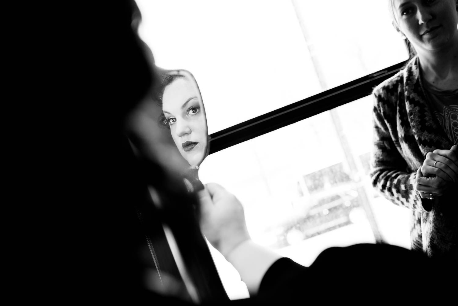 Bride gets ready at Hotel Lincoln before her Chicago wedding at Cafe Brauer.